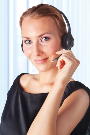 beauty center: Closeup of a female customer service representative working with headset. Can I help you? Stock Photo