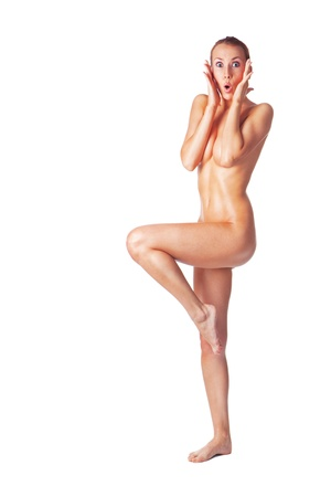 cute nude woman holding her face in astonishment, full length isolated over white background photo