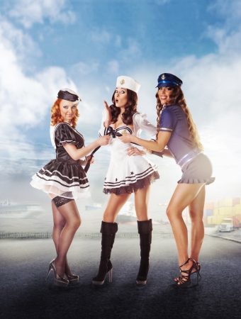 Three sexy sailor women standing in the port Stock Photo - 17425203