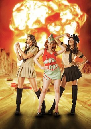 Three military females standing near nuke explosion Stock Photo - 17425204