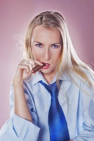 Cute woman smoking a cigar dressed with tie and shirt  photo