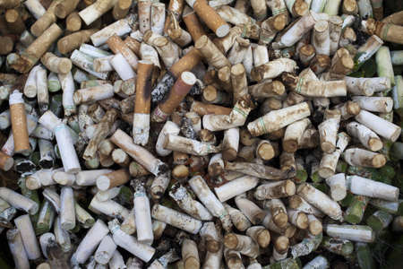 ashtray: A mass of used cigarette butts