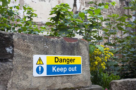A warning sign on a ruined building photo