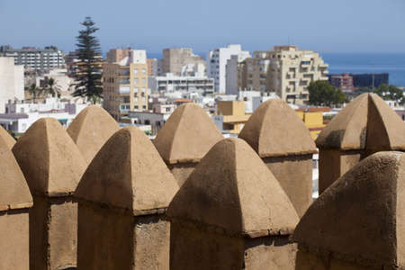 crenelation: View of Almeria town over the battlements of the Alcazaba