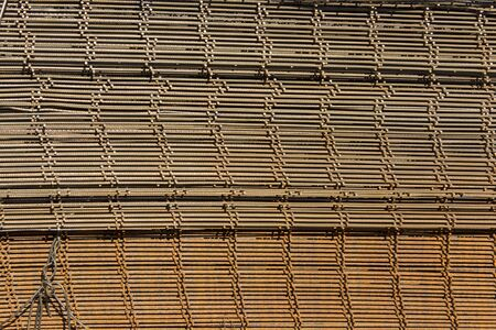 rusty wire: Rusty wire mesh arranged in a pile. Stock Photo