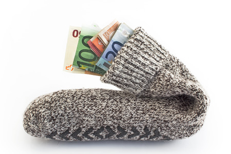 Money in a sock isolated on white.
