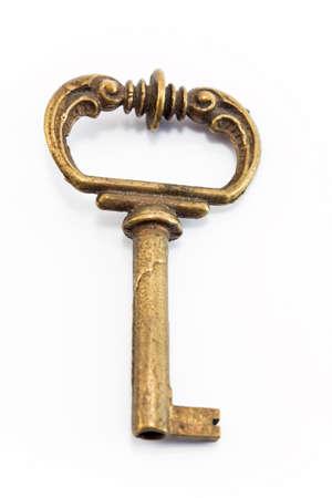 key: Antique key isolated on white. Stock Photo