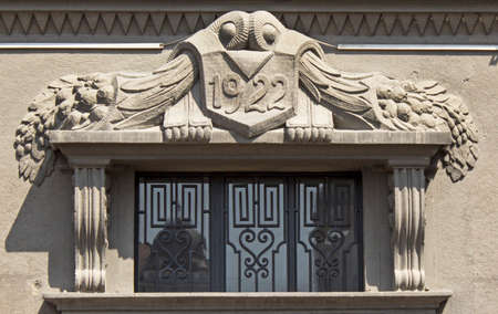 20 s: Ornament above the entrance to the building from 20 s.