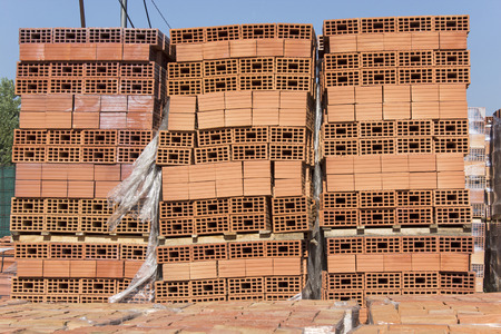 stacked: Building blocks stacked on pallets. Stock Photo