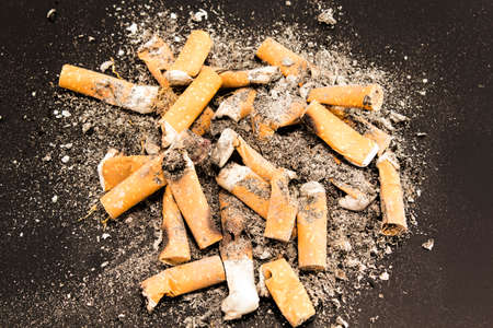 anti smoking: Cigarette butts isolated on a black background.