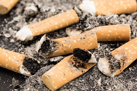 anti smoking: Cigarette butts in a pile close-up.