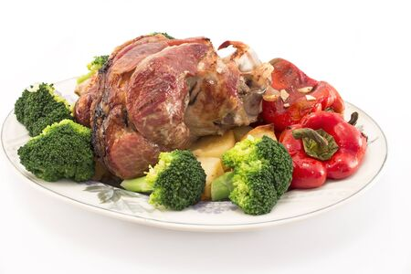 knuckle: Baked pork knuckle with vegetables. Stock Photo