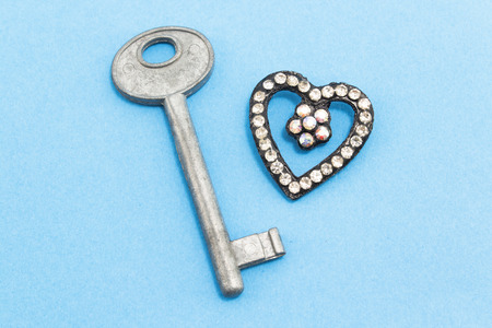 unavailability: Key and Heart of rhinestone on a blue background.