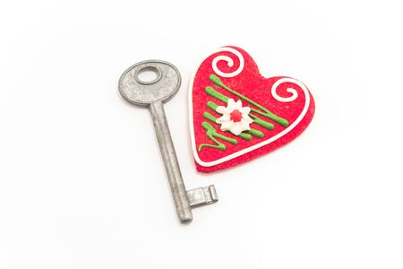 unavailability: Key and heart isolated on white.