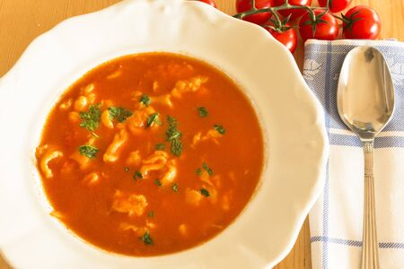 Tomato soup with homemade noodles. Standard-Bild