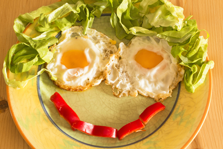 eye red: Smiley breakfast  of eggs and lettuce.