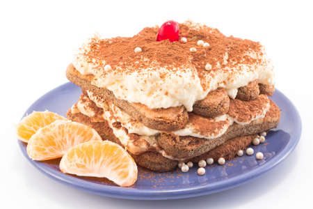 candied: Tiramisu decorated with tangerines, beads and candied cherry