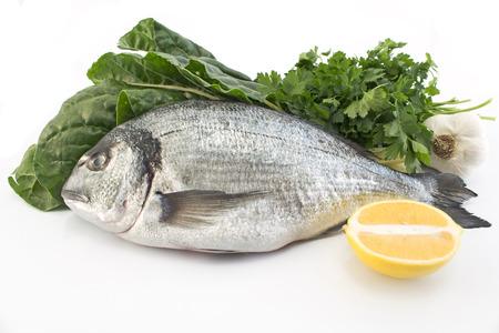 the dorada: Fish dorade with swiss chard, parsley, garlic and lemon. Stock Photo
