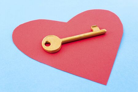 golden key: Red heart and a golden key on a blue background.