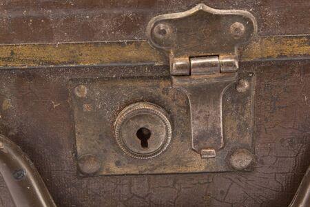 dusty: Rusty, dusty lock on an old suitcase. Stock Photo