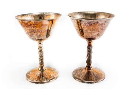 grail: Two silver-plated wine glasses isolated on white.