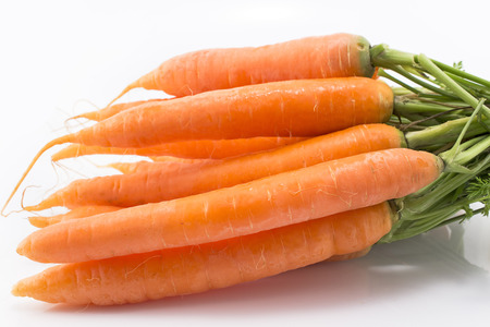 Fresh carrots on a white background.