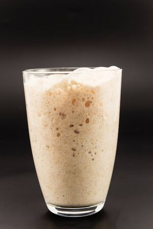 Yeast fermented in a glass .