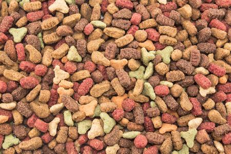 granule: Cat food, granule, as background. Stock Photo