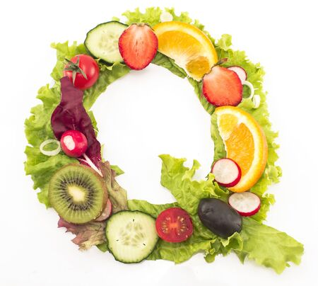letter q: Letter Q made of salad and fruits.