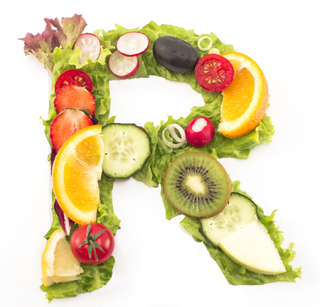 Letter R made of salad and fruits.