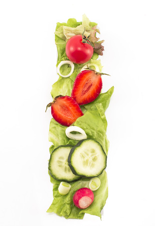 letter i: Letter I made of salad and fruits Stock Photo