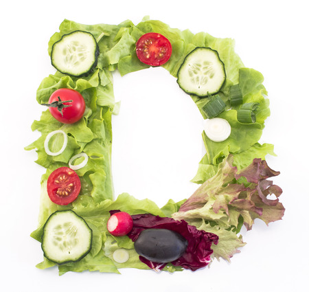 Letter D made of salad.