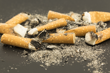anti smoking: Cigarette Butts  on a Black Background.