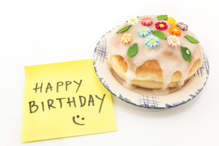 notepaper: Delicious Donut with Happy Birthday Notepaper. Stock Photo