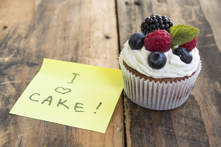 Delicious Cupcake with I Love Cake Notepaper.