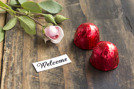 pralines: Welcome Card with Two Pralines and Rose.