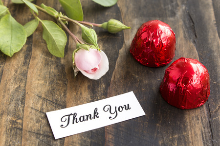short phrase: Thank You Card with Two Pralines and Rose. Stock Photo