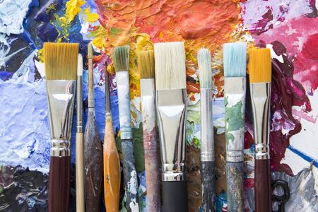 specificity: Various Paintbrushes on a Palette.