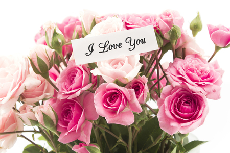 short phrase: I Love You Card with Bouquet of Pink Roses. Stock Photo