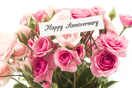 short phrase: Happy Anniversary Card with Bouquet of Pink Roses.