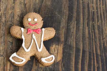 recipe decorated: Christmas Gingerbread Man Cookie on Rustic wooden Background. Stock Photo