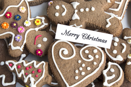 gingerbread cookies: Merry Christmas Greeting Card  with Gingerbread Cookies. Stock Photo