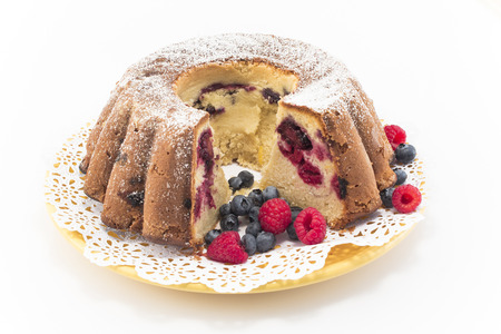 pound cake: Pound Cake with Berries Isolated on White.