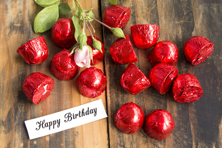 pralines: Happy Birthday Card with Pralines and Rose.