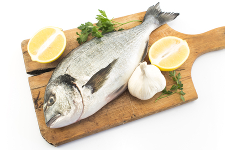 Fish Dorada with Lemon, Parsley and Garlic.