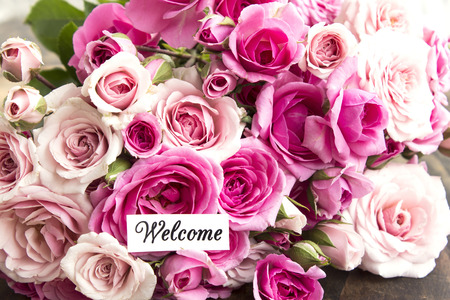 short phrase: Welcome Card with Bouquet of  Pink Roses.