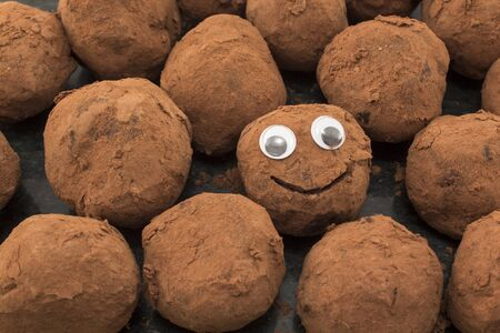 specificity: Concept of Individuality and Curiosity , Smiley Chocolate Truffle. Stock Photo