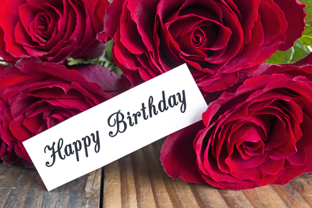short phrase: Happy Birthday Card with Bouquet of Red Roses, Close Up.