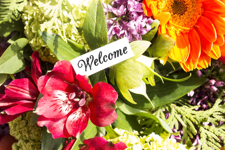 short phrase: Welcome Card with Bouquet of Flowers.