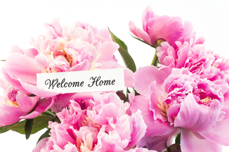 Welcome Home Card with Bouquet of Pink Peonies on White Background.